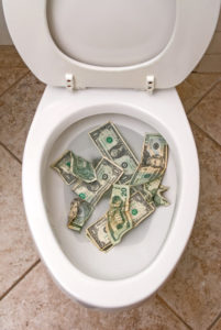 money in a white toilet